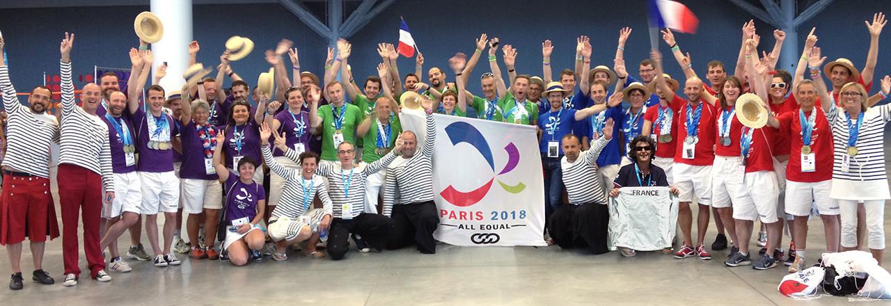 Paris Group Posing with Paris 2018 banner